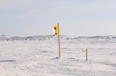 Nunavut flag on frozen Frobisher Bay